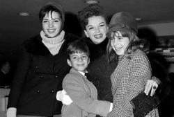 Judy Garland greets her son Joseph, 9, and daughter Lorna, 12, after they arrive from California at New York's Kennedy International Airport, in New York.
