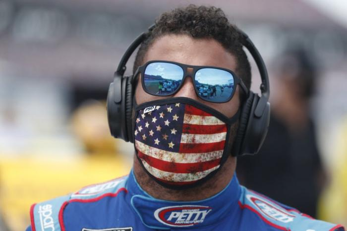 Driver Bubba Wallace walks to his car in the pits of the Talladega Superspeedway prior to the start of the NASCAR Cup Series auto race at the Talladega Superspeedway in Talladega Ala., Monday June 22, 2020.