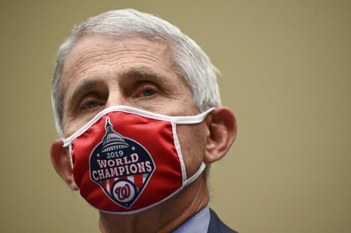 Dr. Anthony Fauci, director of the National Institute for Allergy and Infectious Diseases, arrives to a House Select Subcommittee hearing on the Coronavirus, Friday, July 31, 2020 on Capitol Hill in Washington. (Erin Scott/Pool via AP)