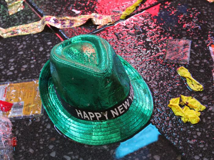 "In this Jan. 1, 2019, file photo a ""Happy New Year"" hat lies on the wet ground along with other items following the celebration in New York's Times Square"