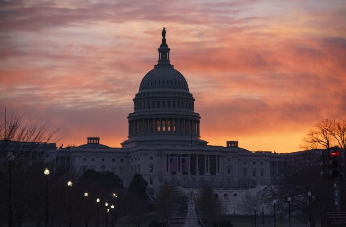 Dawn breaks at the Capitol in Washington.