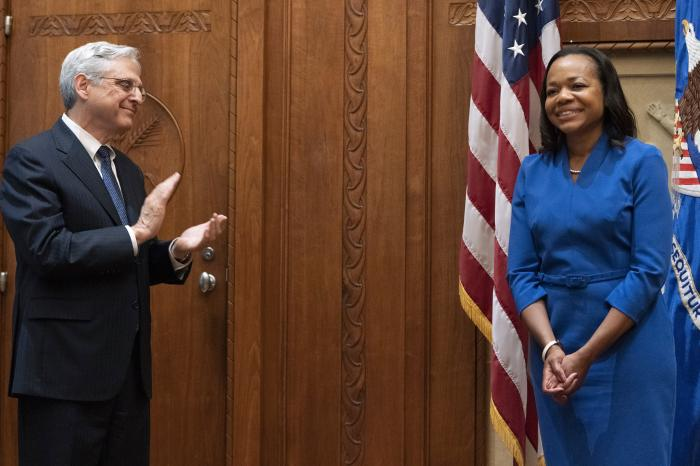 Kristen Clarke, newly sworn in as assistant attorney general for civil rights, reacts as she is congratulated by Attorney General Merrick Garland, left.