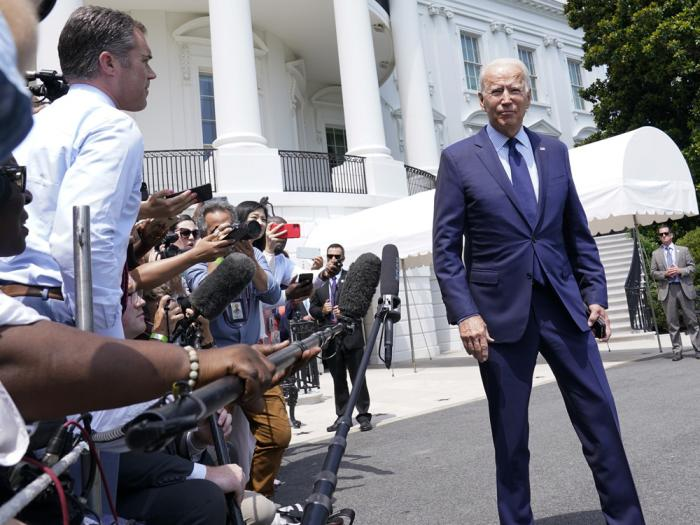 President Joe Biden walks past reporters as he heads to Marine One on the South Lawn of the White House in Washington, Friday, July 16, 2021, to spend the weekend at Camp David