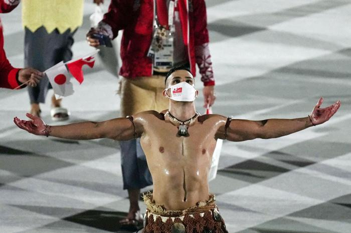Pita Taufatofua, of Tonga, walks during the opening ceremony in the Olympic Stadium at the 2020 Summer Olympics, Friday, July 23, 2021, in Tokyo, Japan. (AP Photo/David J. Phillip)